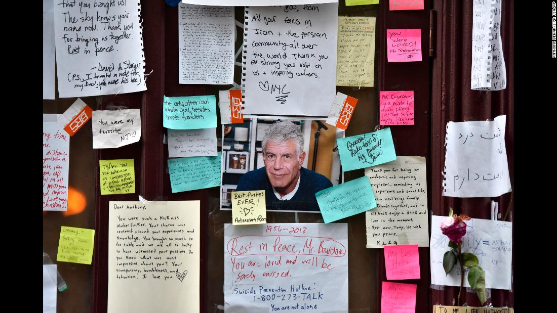 "Tributes to Anthony Bourdain are left outside his former restaurant in New York on Monday, June 11. The gifted chef and storyteller, who took TV viewers around the world to explore culture, cuisine and the human condition, <a href=""https://www.cnn.com/2018/06/08/us/anthony-bourdain-obit/index.html"" target=""_blank"">was found dead at his hotel room in France</a> on June 8. The 61-year-old took his own life. <a href=""https://www.cnn.com/2018/06/08/us/gallery/anthony-bourdain/index.html"" target=""_blank"">See Bourdain's life in pictures</a>"