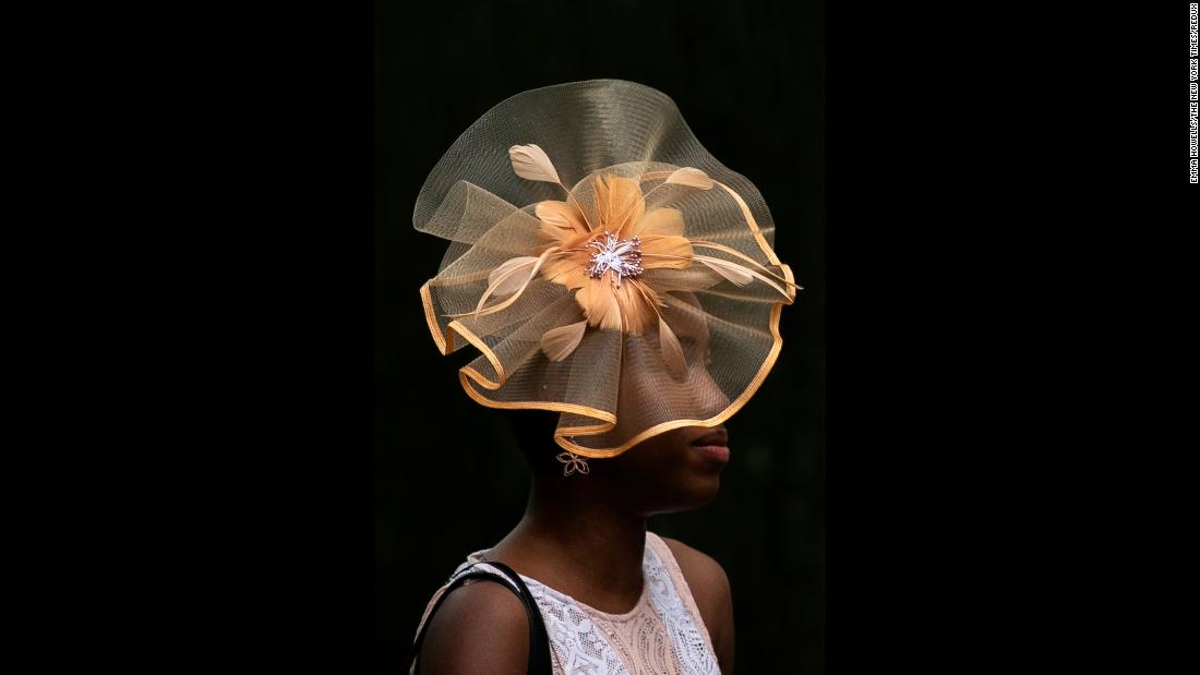 "A racegoer wears a fancy hat ahead of the <a href=""http://www.cnn.com/2018/06/09/sport/gallery/justify-triple-crown/index.html"" target=""_blank"">Belmont Stakes</a> in Elmont, New York, on Saturday, June 9."