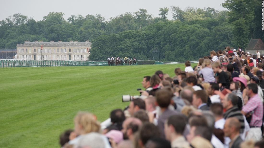 The Hippodrome de Chantilly features three interlinked tracks surrounded by woodland in France's main horse racing center. The first race was held here in 1834 with the grandstand added in 1879.
