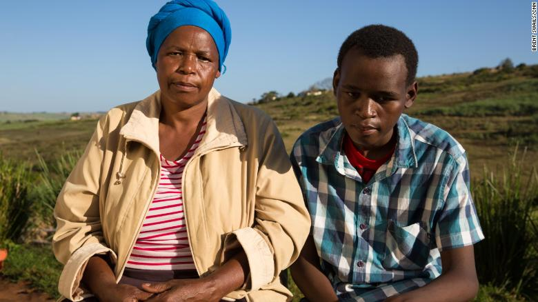 Khumbulani Shandu and his mother at their homestead in KwaZulu-Natal. Khumbulani was made deaf and partially blind because of the toxic TB drugs.