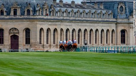 The race course passes Chantilly's iconic Great Stables.