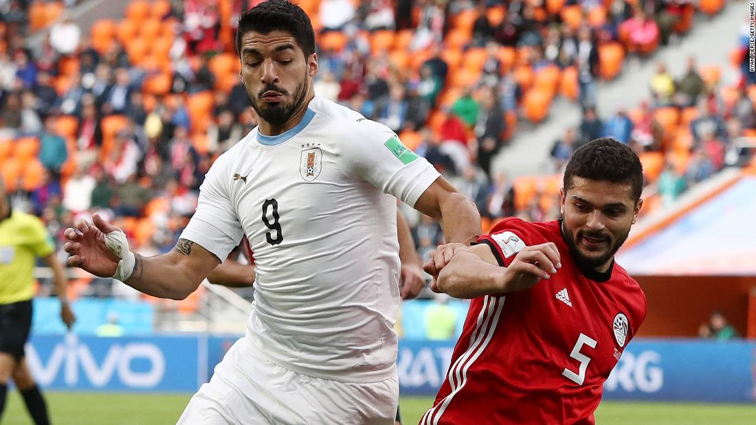 Uruguay's Luis Suarez, left, and Egypt's Sam Morsy battle for the ball.