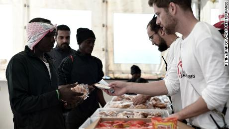 An MSF team serves rescued people breakfast on Friday made from food supplies delivered to the Aquarius the previous day.