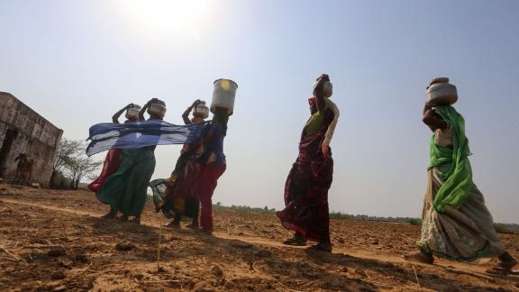 Indian women fetch water from a pit in the bed of Lokpal Sagar Lake in Madhya Pradesh.