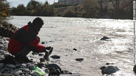 In December 2017, a migrant washes his shoes in the river Roya, which runs through the town of Venitmiglia.