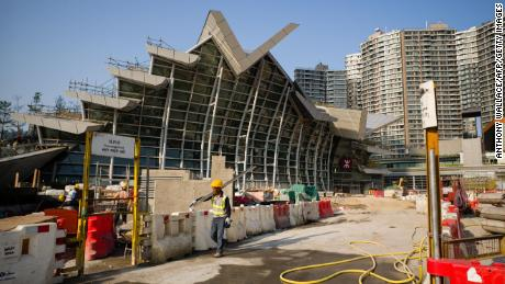 A worker walks outside the West Kowloon station of the Express Rail Link train to Guangzhou in Hong Kong on March 23.
