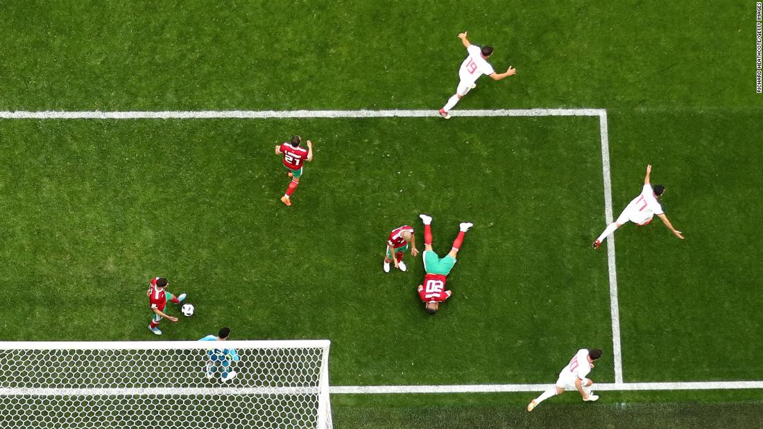 Morocco's Aziz Bouhaddouz lies on the ground after heading the ball into his own net late in stoppage time on June 15. The whistle was blown just a few moments later, and Iran won 1-0.
