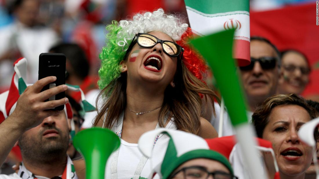 Fans enjoy the atmosphere before the Iran-Morocco match.