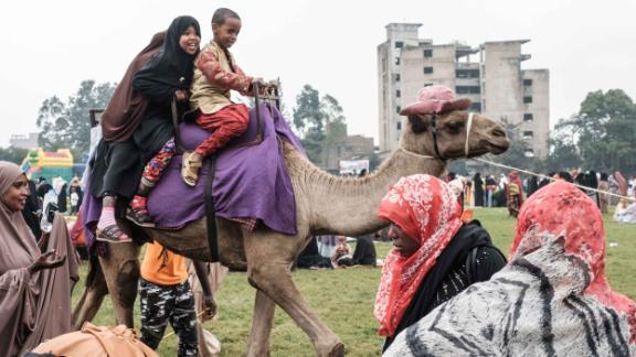 Children take a camel ride after Eid al-Fitr prayers in Nairobi, Kenya.