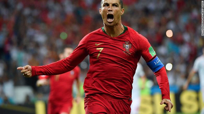 Portugal star Cristiano Ronaldo celebrates his first-half penalty against Spain on Friday, June 15. He added two more goals in the 3-3 draw.