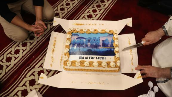 Worshippers in London celebrate by cutting a cake in 2018 as Ramadan ends and Eid al-Fitr begins.