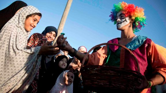 A clown gives out candy in Gaza City.