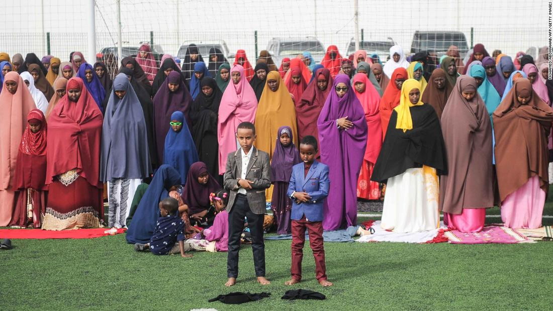 Somalis take part in Eid al-Fitr prayers on a football pitch in Mogadishu.