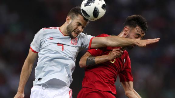 Spanish defender Nacho, left, competes for a header with Portugal