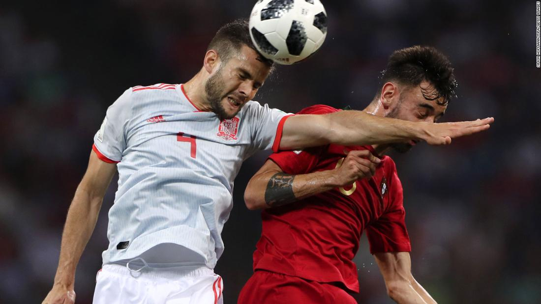 Spanish defender Nacho, left, competes for a header with Portugal's Bruno Fernandes. Nacho conceded the early penalty to Ronaldo but responded with a second-half goal.
