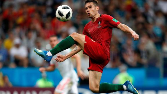 Portuguese defender Raphael Guerreiro controls the ball in the match against Spain.