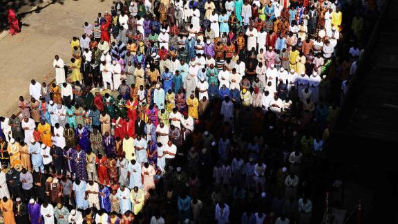 Muslims participate in an outdoor prayer event at the Masjid Aqsa-Salam mosque, Manhattan
