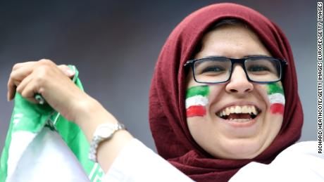A female Iran fan cheers on her national team against Morocco at the World Cup.