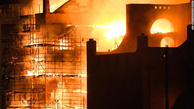 GLASGOW, SCOTLAND - JUNE 16:  Fire fighters battle a blaze at the Mackintosh Building at the Glasgow School of Art for the second time in four years on June 16, 2018 in Glasgow, Scotland. In May 2014 it was devastated by a huge fire leading to a multi-million pound restoration due to complete in 2019. It was built in the late 1890's by Charles Rennie Mackintosh, then a junior draughtsman, and is widely considered to be his masterpiece. (Photo by Jeff J Mitchell/Getty Images)
