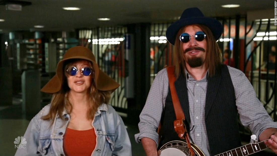 Pop star in disguise stuns subway riders