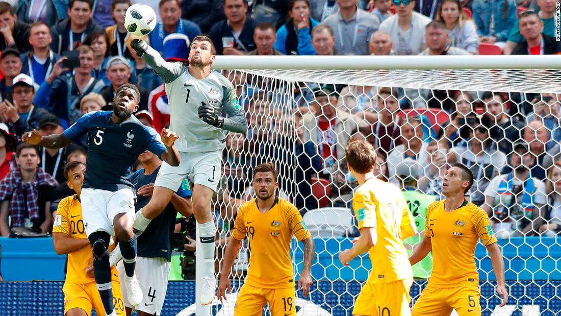 Australian goalkeeper Mathew Ryan punches the ball clear from France's Samuel Umtiti.