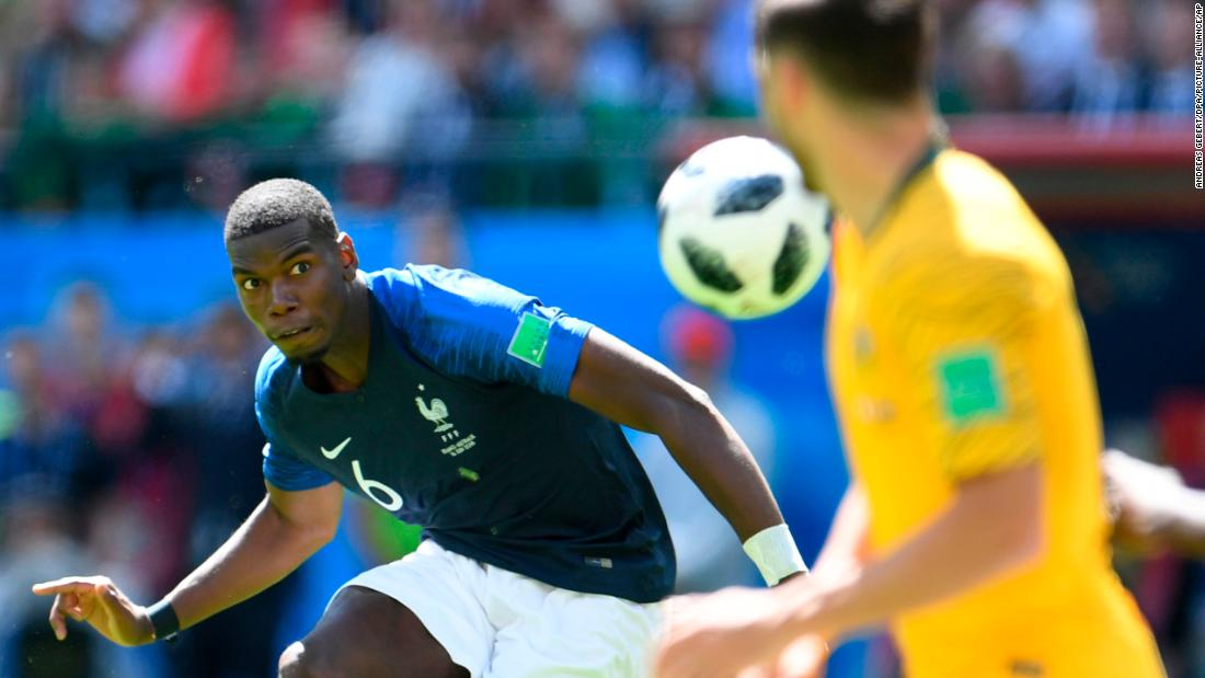 French midfielder Paul Pogba keeps his eye on the ball against Australia. His shot deflected off an Australian for the match-winning goal.