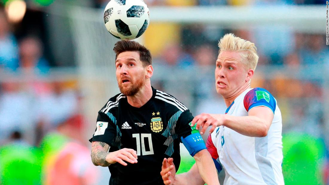 Messi and Iceland's Hordur Magnusson struggle for the ball.