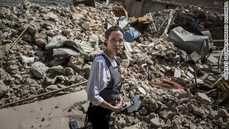 UNHCR Special Envoy Angelina Jolie visits the Old City in West Mosul during a visit to Iraq. Local residents told her the corpses of several militants are still buried in the rubble behind her.  © UNHCR/Andrew McConnell