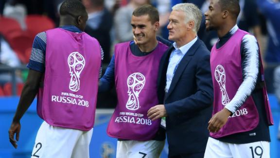 Antoine Griezmann celebrates with France coach Didier Deschamps at the final whistle.