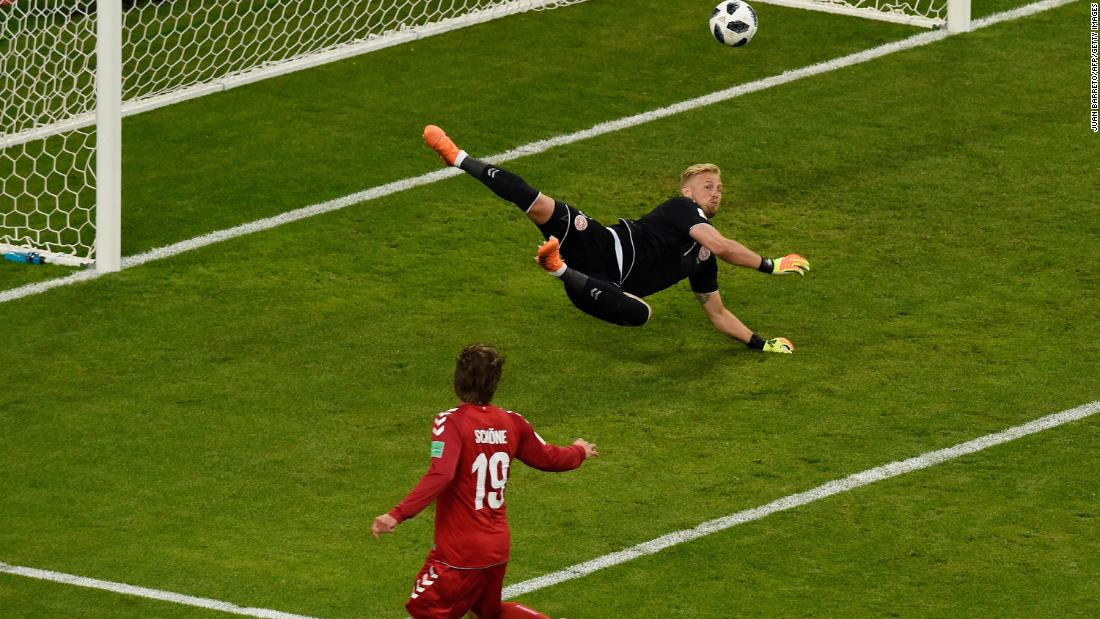 Danish goalkeeper Kasper Schmeichel makes a save during the match.