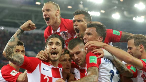 Croatian players celebrate after Luka Modric scored the second goal of their 2-0 win against Nigeria on June 16.