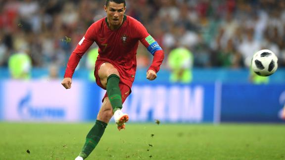 Ronaldo scores his third goal for Portugal in the 3-3 draw against Spain at the World Cup
