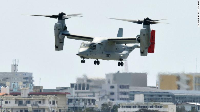 GINOWAN, Japan - A U.S. Marine Corps MV-22 Osprey transport aircraft lands at the Marines' Futenma Air Station in Ginowan, Okinawa Prefecture, on Oct. 2, 2012, as three more Ospreys flew to the Futenma base for deployment from another base in Iwakuni, Yamaguchi Prefecture. Six Ospreys had arrived at Futenma from Iwakuni the previous day. (Photo by Kyodo News via Getty Images)