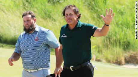Phil Mickelson (right) played with England's Andrew Johnston Saturday.