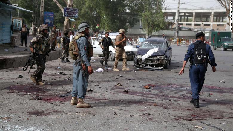 epa06815348 Afghan security officials inspect the scene of a suicide bombing that targeted the participants of a meeting between Taliban militants and the Governor of Nangarhar province, outside the Governor's office in Jalalabad, Afghanistan, 17 June 2018. According to media reports, ten people were killed and dozens injured in an explosion outside the governor's office in the eastern province of Nangarhar as participants were leaving after a meeting to discuss ceasefire between the Afghan government and Talibans. The Taliban on 17 June ordered its fighters not to visit areas controlled by the Afghan government, a day after an attack by the Islamic State terror group against a gathering of insurgents and civilians left 36 dead.  EPA/GHULAMULLAH HABIBI ATTENTION: GRAPHIC CONTENT