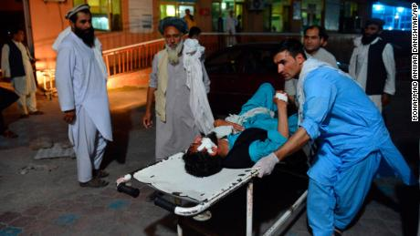 An injured man is carried to a hospital in Jalalabad on June 16