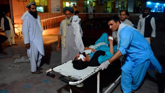 An injured man is brought by stretcher on June 16, into a hospital in Jalalabad, Afghanistan.