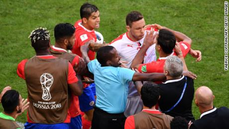 Serbia midfielder Nemanja Matic confronts Costa Rica players following an altercation with one of the coaches.