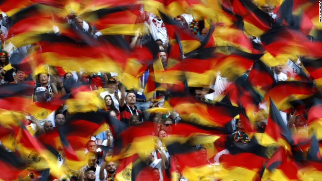 Fans wave German flags before facing off with Mexico.