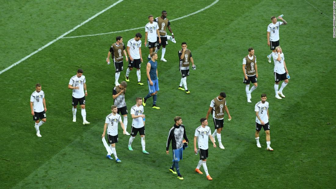 A dejected German team leaves the pitch after losing its World Cup opener to Mexico. Germany, the defending champions, lost 1-0 to a goal from Hirving Lozano.