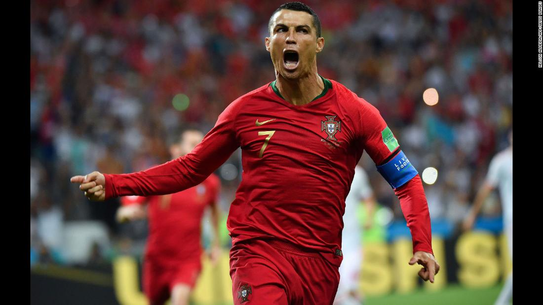 Portugal star Cristiano Ronaldo celebrates his first-half penalty in the World Cup match against Spain on Friday, June 15. He added two more goals in the 3-3 draw.