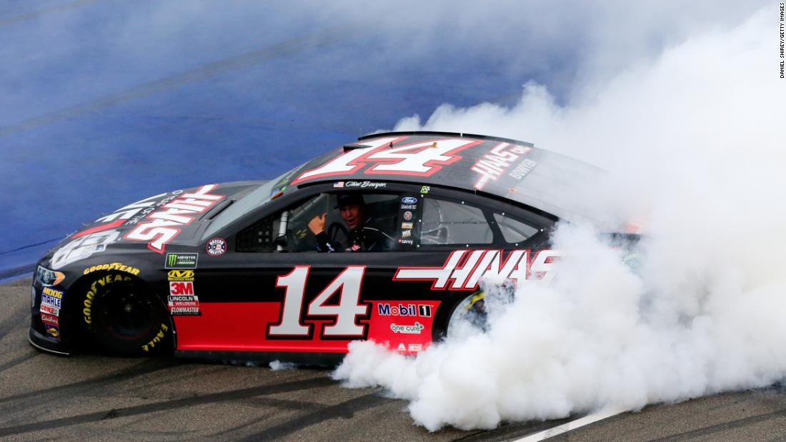 Clint Bowyer, driver of the #14 Haas 30 Years of the VF1 Ford, celebrates with a burnout after winning the Monster Energy NASCAR Cup Series FireKeepers Casino 400 on Sunday, June 10 in Brooklyn, Michigan.