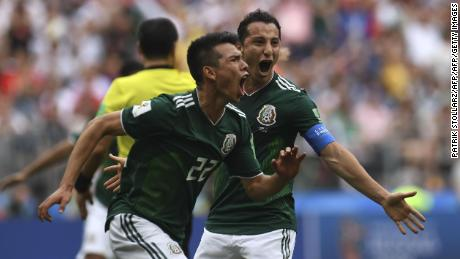 Mexico's forward Hirving Lozano (C) celebrates after opening the scoring against Germany.