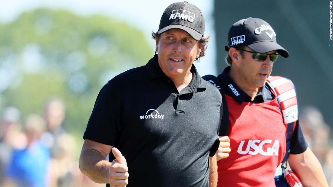 "Phil Mickelson was back a day after sparking the ""putt-gate"" controversy when he hit his still moving ball back towards the hole. The left-hander, who improved on Saturday's 81 with a closing 69 to end +16, declined to offer any further comment on the incident."