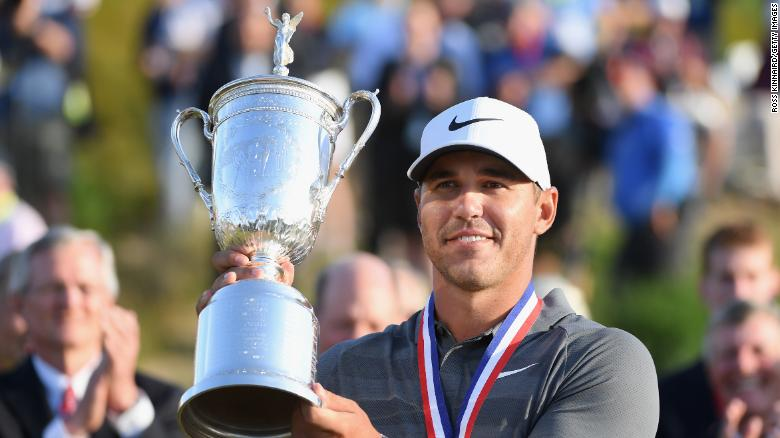 SOUTHAMPTON, NY - JUNE 17: Brooks Koepka of the United States celebrates with the U.S. Open Championship trophy during the trophy presentation after winning the 2018 U.S. Open at Shinnecock Hills Golf Club on June 17, 2018 in Southampton, New York.  (Photo by Ross Kinnaird/Getty Images)