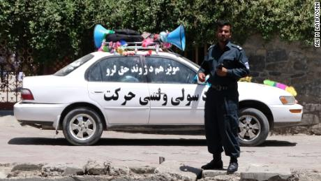 "A vehicle belonging to the Helmand peace march reads ""The People's Peace Movement."""