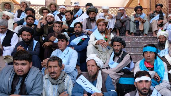 Members of the Helmand Peace March sit with supporters and well-wishers from Kabul.