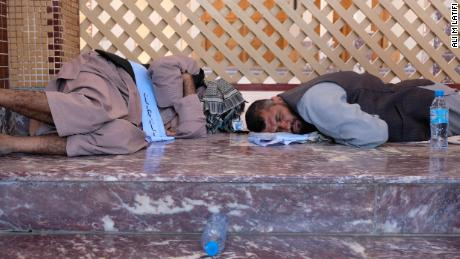 Two of the marchers rest in the Abdul Rahman mosque in Kabul. Mosques were the marchers' chief refuge during their 700-kilometer (435-mile), 38-day trek.