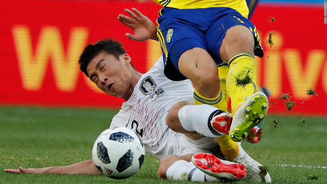 South Korean fullback Lee Yong slides in on Claesson.