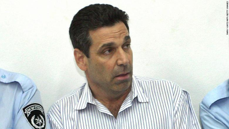 TEL AVIV, ISRAEL:  Former Israeli energy minister Gonen Segev (C) appears at the Tel Aviv district tribunal 22 April 2004. Segev was remanded in custody after having been arrested on suspicion of attempted drug-trafficking. The court ordered that Segev remain in custody until April 28. Segev, who had served as a minister in the cabinet of the late Labour party prime minister Yitzak Rabin, is accused of trying to smuggle 25,000 ecastasy tablets from Holland by changing the date on an out-of-date diplomatic passport. AFP PHOTO/Yariv KATZ -- ISRAEL OUT  (Photo credit should read YARIV KATZ/AFP/Getty Images)